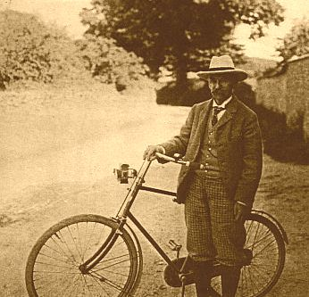 Thomas Hardy with his bicycle